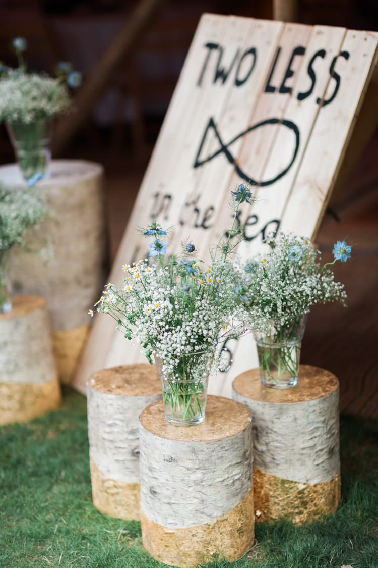 Log Flowers Decor Outdoor Beautifully Romantic Eclectic Tipi Wedding http://www.jobradbury.co.uk/
