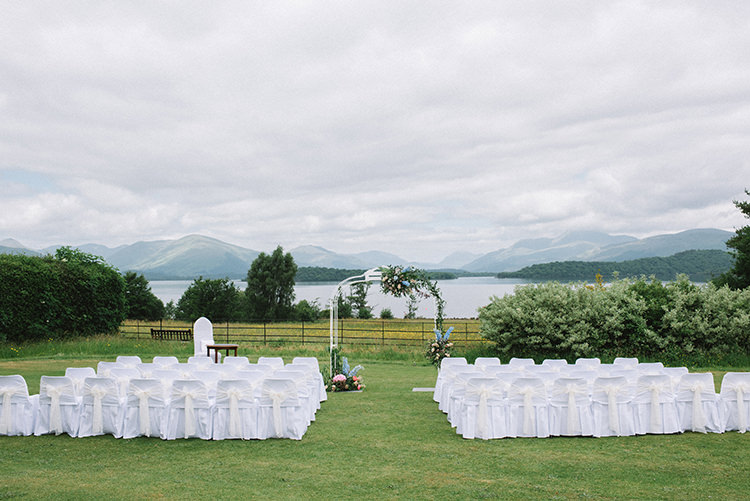 Ceremony White Chair Covers Archway Hydrangeas Pink Blue Greenery Scenic Outdoor Loch Lomond Wedding http://www.lisadevinephotography.co.uk/