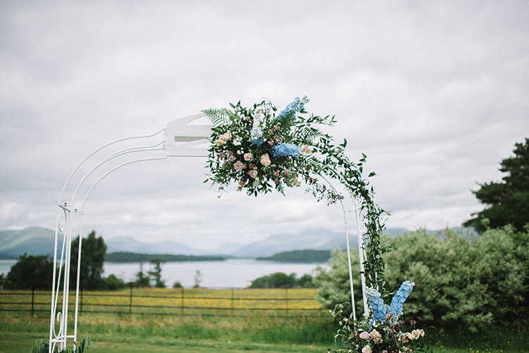 Ceremony Arch Backdrop Pink Blue Floral Flowers Greenery Scenic Outdoor Loch Lomond Wedding http://www.lisadevinephotography.co.uk/