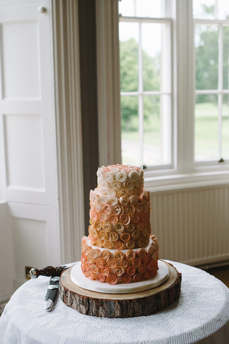 Cake Table Wood Slice Icing Rose Scenic Outdoor Loch Lomond Wedding http://www.lisadevinephotography.co.uk/