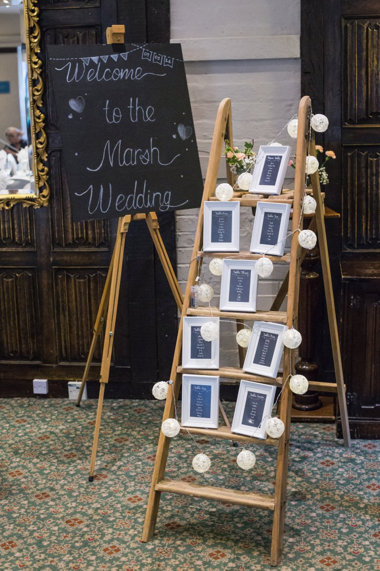 Welcome Sign Blackboard Chalk Board Stepladder Table Plan Easel Seating Chart Frames String Lights Detail Decor Pretty Quirky Pastel Wedding http://www.happilyevercaptured.com/