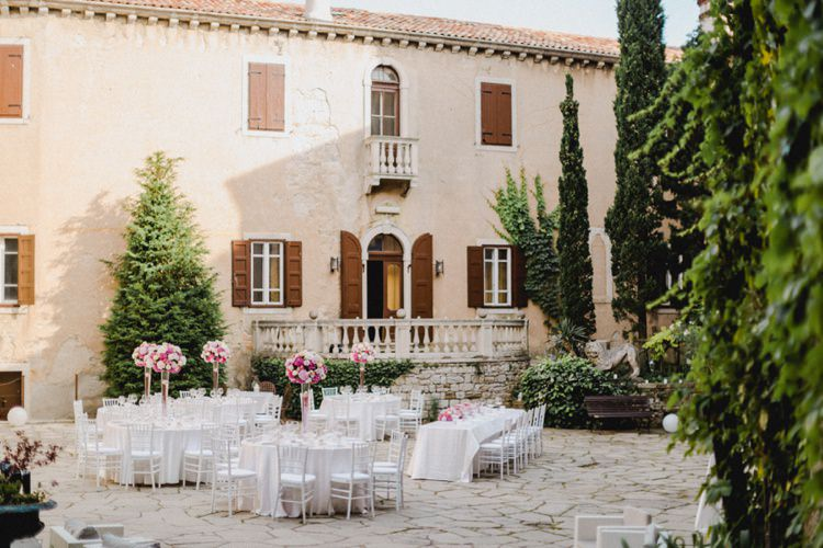 Outdoor Reception White Tables Chairs Romantic Vibrant Pink Wedding Trieste http://www.emotionttl.com/en/home/