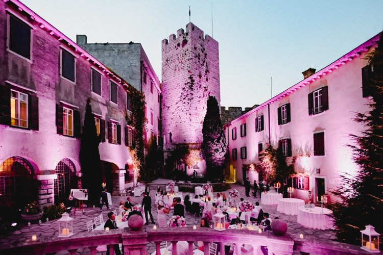Castle Courtyard Reception Lighting Romantic Vibrant Pink Wedding Trieste http://www.emotionttl.com/en/home/