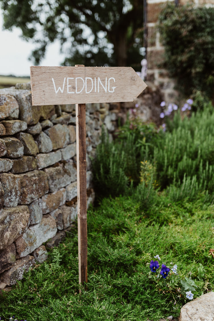 Rustic Wooden Sign Post Painted White Beautifully Relaxed Outdoorsy Barn Wedding http://www.caitlinandjones.co.uk/