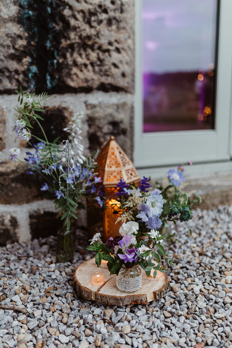 Lanterns Candles Log Flowers Jars Decor Beautifully Relaxed Outdoorsy Barn Wedding http://www.caitlinandjones.co.uk/