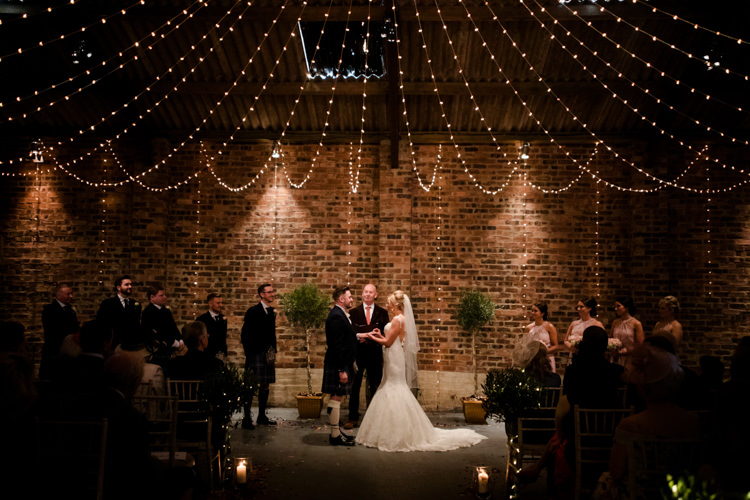 Fairy Lights Ceremony Magical Blush Pink Gold Barn Wedding http://www.johnjohnstonphotography.co.uk/