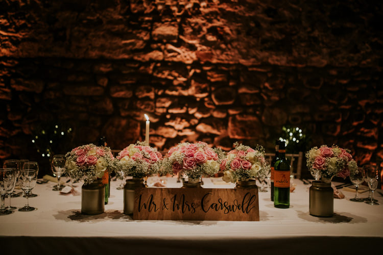 Jar Flowers Roses Sign Calligraphy Wooden Magical Blush Pink Gold Barn Wedding http://www.johnjohnstonphotography.co.uk/
