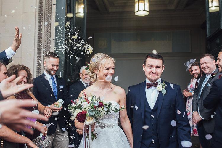 Confetti Throw Bride Groom Town Hall Liverpool Stylish Lakeside City Wedding http://www.struthphotography.com/