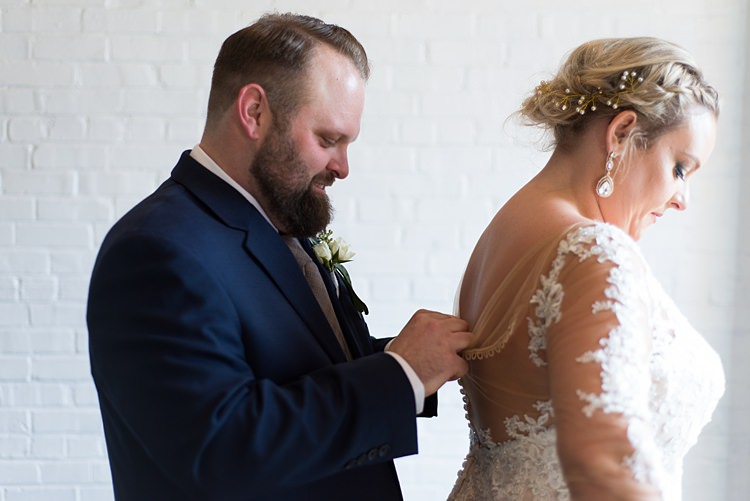 Bride Getting Ready Buttons Groom Romantic Industrial Studio Loft Georgia Wedding http://krisandraevans.com/