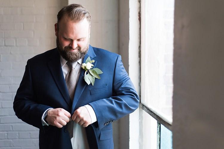 Groom Navy Suit Getting Ready Romantic Industrial Studio Loft Georgia Wedding http://krisandraevans.com/