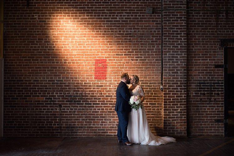 Bride Groom Kiss Romantic Industrial Studio Loft Georgia Wedding http://krisandraevans.com/