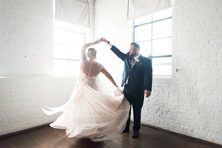 Bride Groom Twirl Spin Dress Romantic Industrial Studio Loft Georgia Wedding http://krisandraevans.com/
