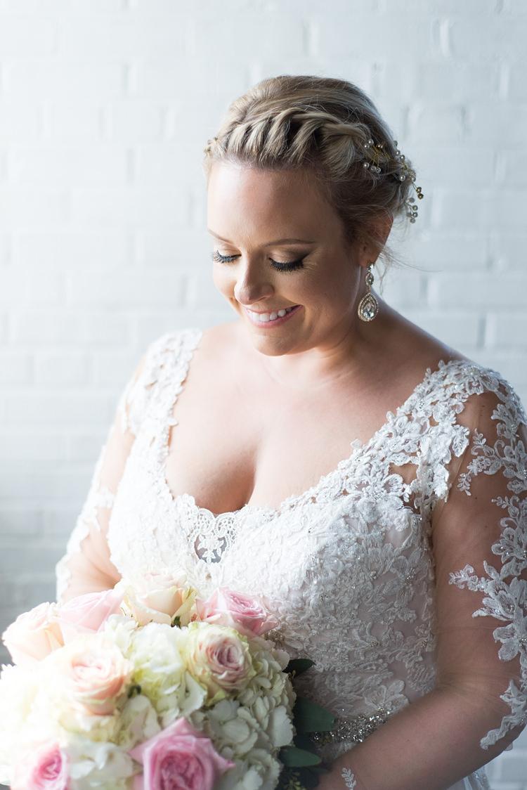 Bride Lace Sleeves Detail Bouquet Romantic Industrial Studio Loft Georgia Wedding http://krisandraevans.com/