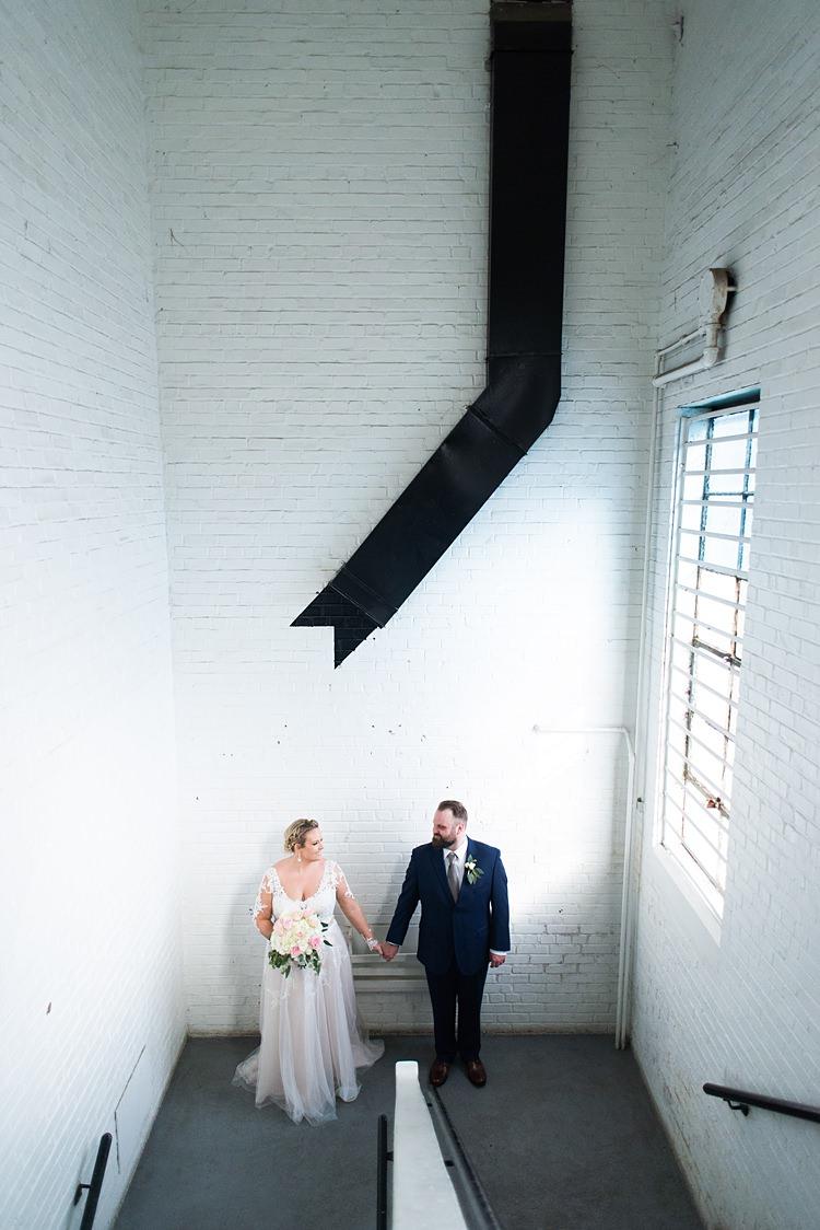 Bride Groom Handholding Romantic Industrial Studio Loft Georgia Wedding http://krisandraevans.com/