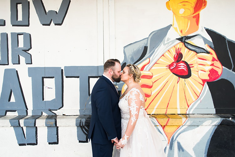 Art Poster Kiss Bride Groom Romantic Industrial Studio Loft Georgia Wedding http://krisandraevans.com/