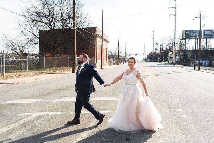 Bride Groom Handholding Road Street Romantic Industrial Studio Loft Georgia Wedding http://krisandraevans.com/