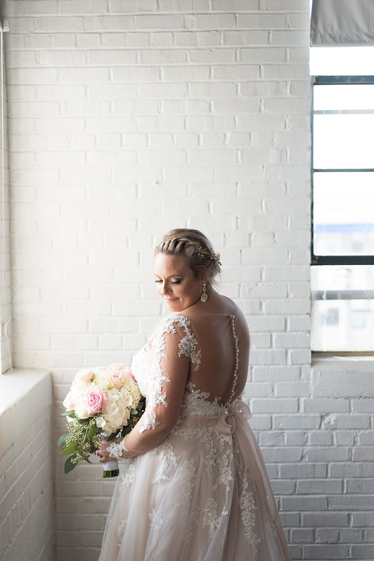 Bride Dress Back Detail Lace Sleeves Buttons Romantic Industrial Studio Loft Georgia Wedding http://krisandraevans.com/