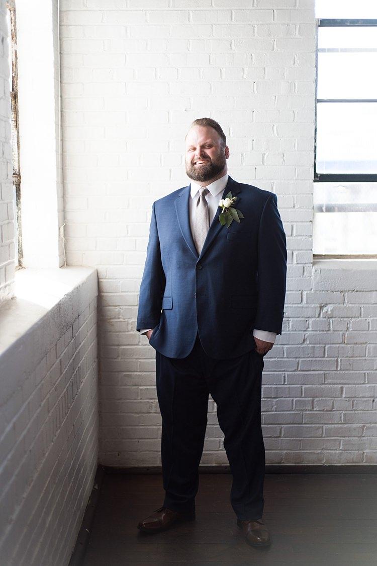 Groom Laughing Navy Suit Romantic Industrial Studio Loft Georgia Wedding http://krisandraevans.com/