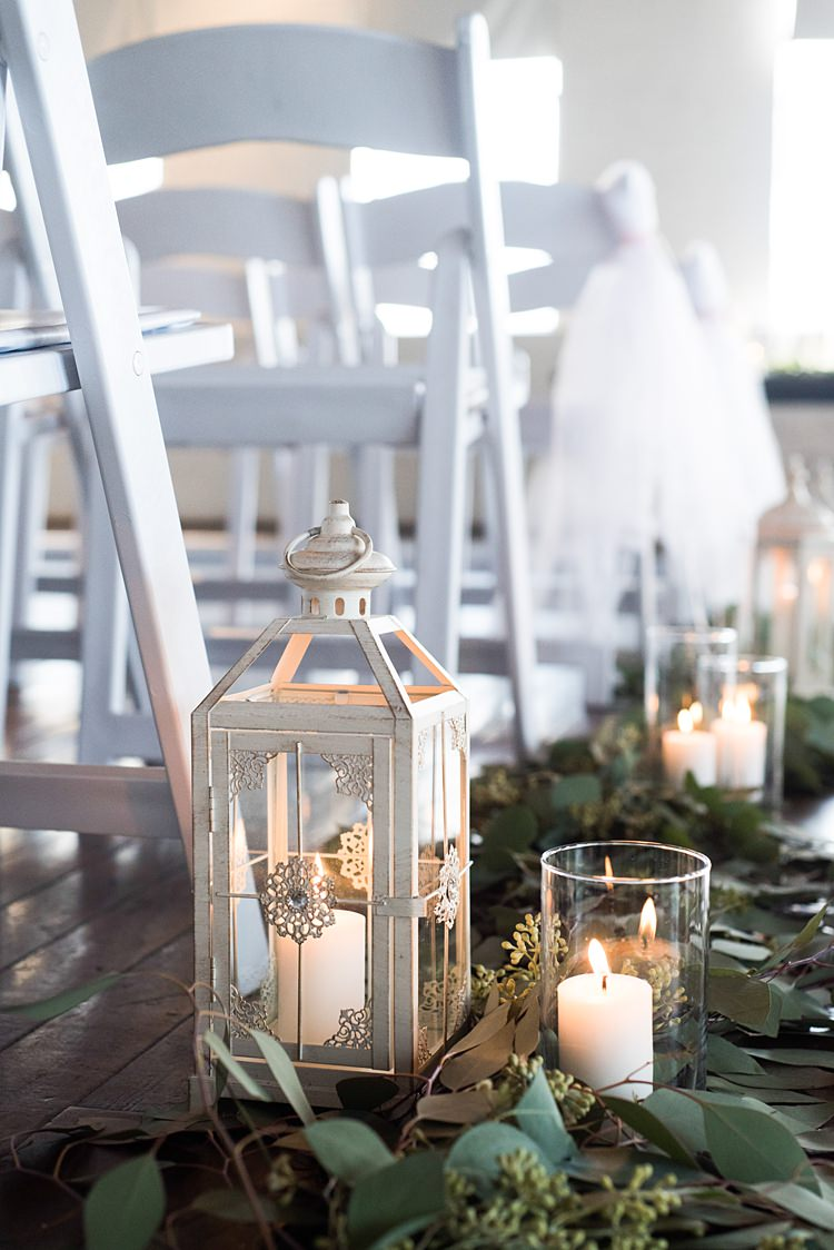 Aisle Lanterns Candles Greenery Romantic Industrial Studio Loft Georgia Wedding http://krisandraevans.com/