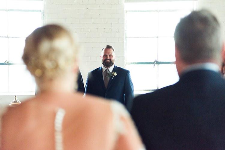 Bride Aisle Smiling Groom Romantic Industrial Studio Loft Georgia Wedding http://krisandraevans.com/