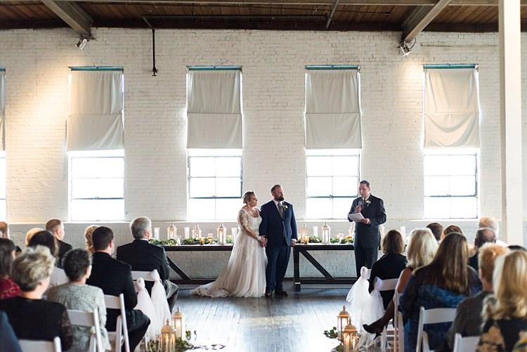 Ceremony Guests Bride Groom Romantic Industrial Studio Loft Georgia Wedding http://krisandraevans.com/