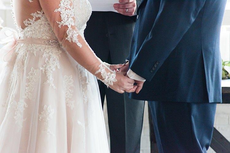 Bride Groom Handholding Ceremony Romantic Industrial Studio Loft Georgia Wedding http://krisandraevans.com/