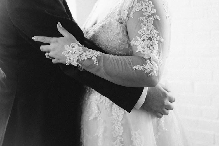 Bride Groom Embrace Lace Romantic Industrial Studio Loft Georgia Wedding http://krisandraevans.com/