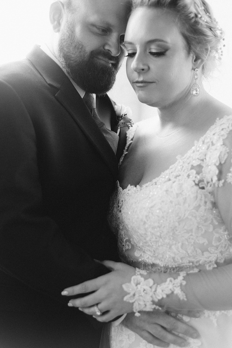Bride Groom Embrace Close Lace Dress Romantic Industrial Studio Loft Georgia Wedding http://krisandraevans.com/