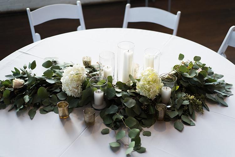 Table Decoration Greenery Candles Romantic Industrial Studio Loft Georgia Wedding http://krisandraevans.com/