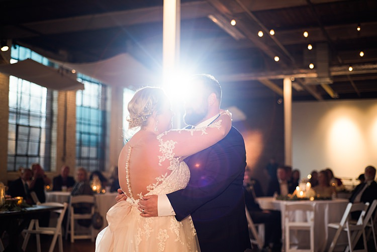 Bride Groom First Dance Lace Dress Back Romantic Industrial Studio Loft Georgia Wedding http://krisandraevans.com/