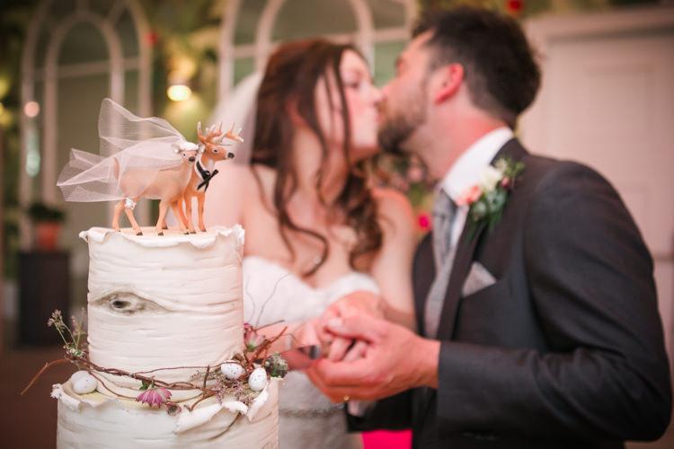 Cake Cutting Wood Twigs Mini Eggs Deer Topper Bride Groom Easter Spring Woodland Wedding http://emmastonerweddings.com/