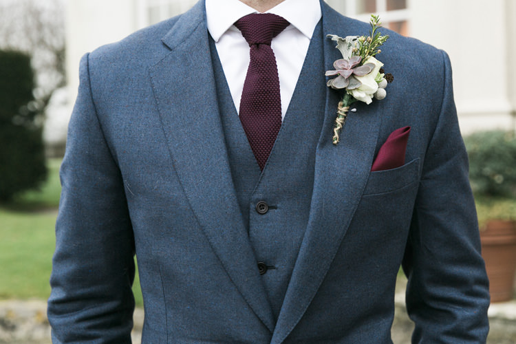 Groom Cad and the Dandy Three Piece Wool Blue Waistcoat Burgandy Blue Pocket Square Gorgeously Glam New Years Eve Wedding http://www.photographybykrishanthi.co.uk/