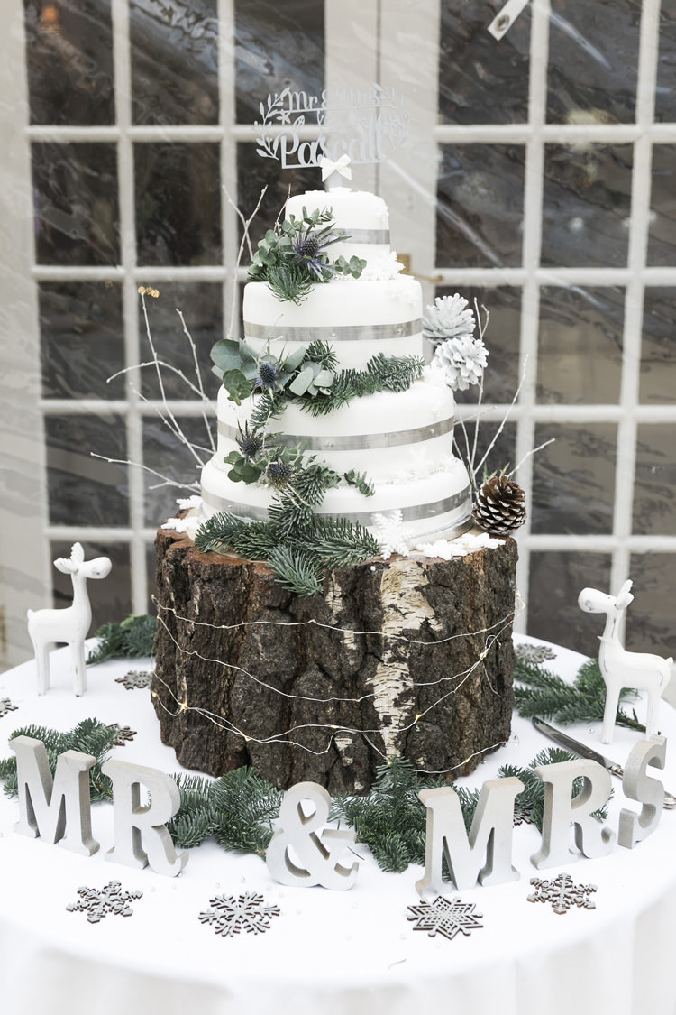 Cake Table Wood Slice Rustic Pine Greenery White Silver Gorgeously Glam New Years Eve Wedding http://www.photographybykrishanthi.co.uk/