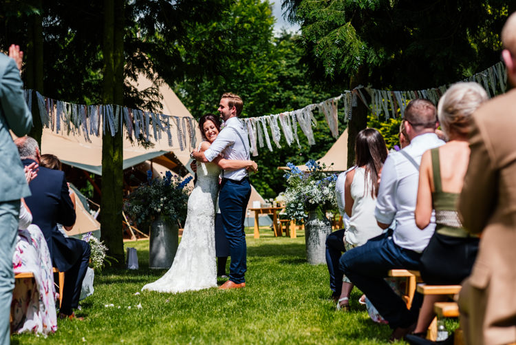 Outdoor Ceremony Bedfordshire Fun Loving Secret Garden Tipi Wedding https://www.aaroncollettphotography.co.uk/