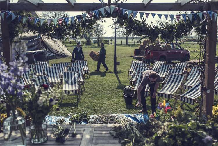 Ceremony Deck Chairs Bunting Arch Greenery Foliage Garland Floral Quirky Seaside Farm Wedding http://www.thomasthomasphotography.co.uk/