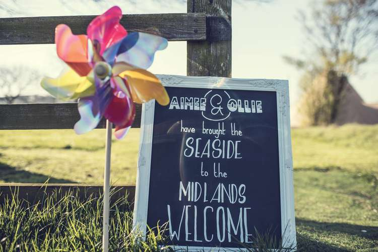 Welcome Sign Chalkboard Frame Pinwheel Quirky Seaside Farm Wedding http://www.thomasthomasphotography.co.uk/