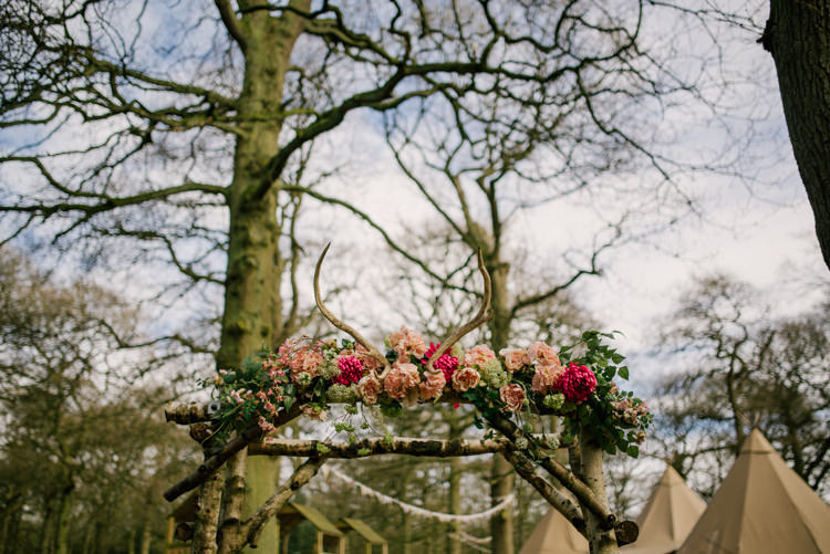 Floral Pink Antler Archway Wood Flower Garland Magical Cosy Forest Tipi Wedding http://katewatersphotography.com/