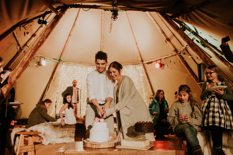Cake Table Cutting Wood Slice Magical Cosy Forest Tipi Wedding http://katewatersphotography.com/