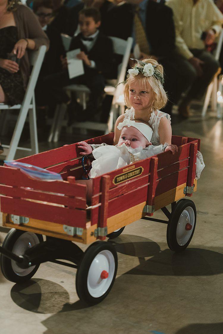 Flower Girl Wagon Aisle Cart Hip Art Gallery Wedding Colorado http://www.lisarundallphotography.com/