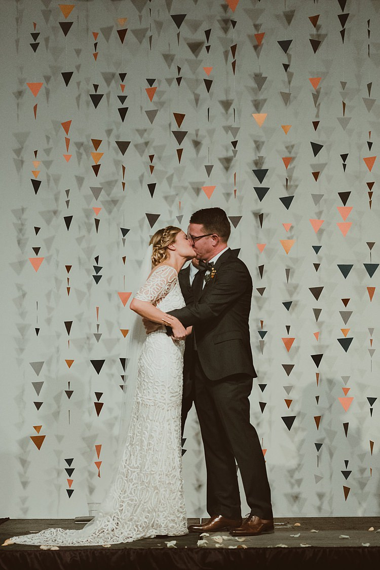 Geometric Hanging Paper Triangle Backdrop Ceremony Hip Art Gallery Wedding Colorado http://www.lisarundallphotography.com/