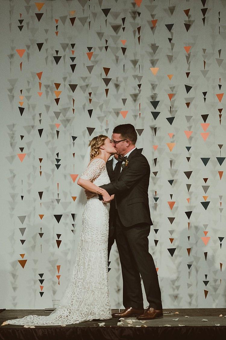 Geometric Hanging Paper Triangle Backdrop Ceremony Hip Art Gallery Wedding Colorado http://www.lisarundallphotography.com/