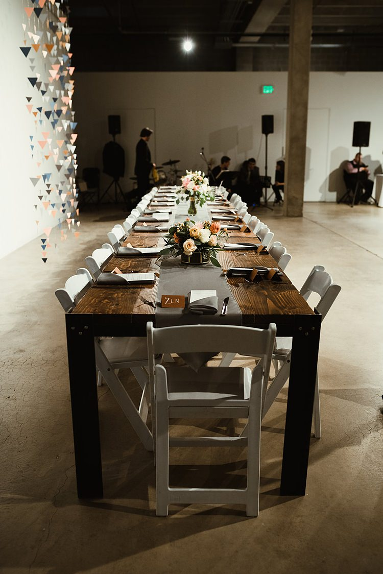 Long Rustic Tables Hip Art Gallery Wedding Colorado http://www.lisarundallphotography.com/