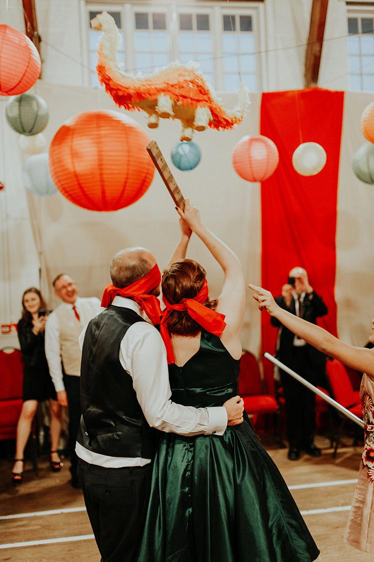 Piñata Game Bride Groom Entertainment All The Colours Quirky Dinosaur Wedding https://leahlombardi.com/
