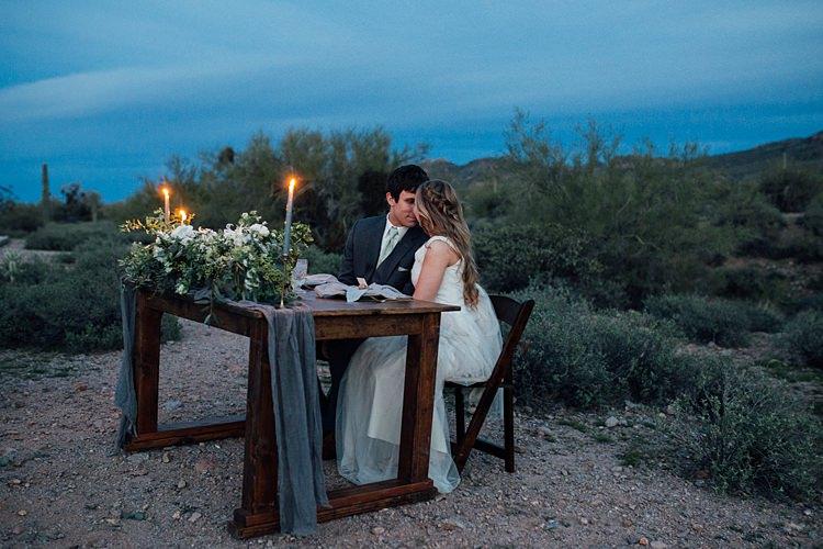 Bride Groom Close Seated Candlelight Romantic Desert Elopement Ideas http://beginningandendphoto.com/