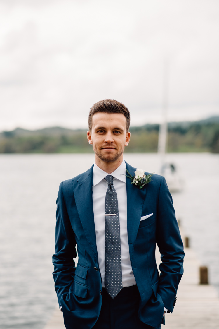 Navy Blue Suit Groom Polka Dot Tie Bespoke Custom Delightfully Stylish Spring Wedding in the Lake District http://jamiedunnphotography.com/