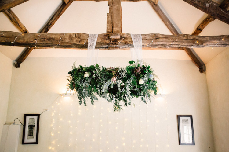 Hanging Hoop Flowers Ceremony Foliage Greenery Delightfully Stylish Spring Wedding in the Lake District http://jamiedunnphotography.com/