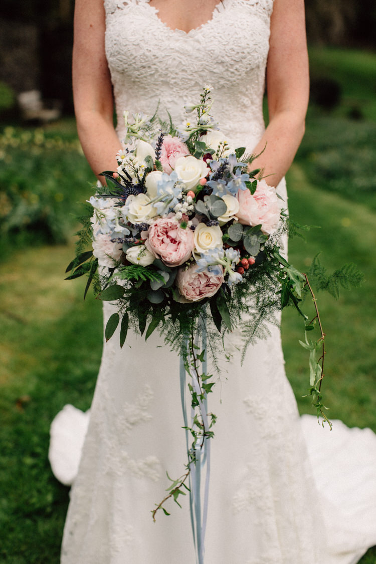 Bouquet Flowers Bride Bridal Prony Thistle Fern Rose Pink Blue Cream Delightfully Stylish Spring Wedding in the Lake District http://jamiedunnphotography.com/