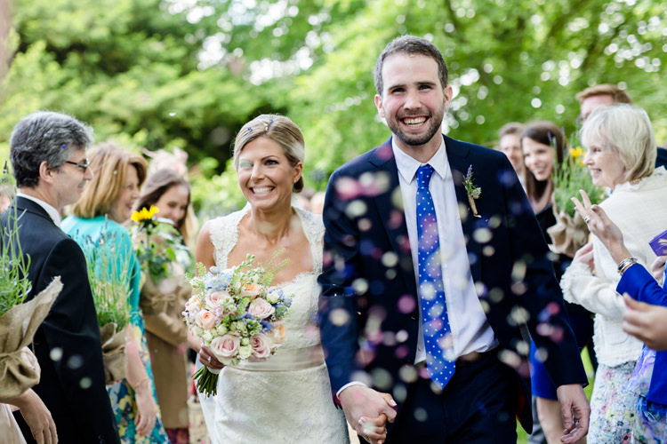 Confetti Shot Moment Bridal Bridal Paloma Blanca Gown Dress Suit Supply Groom Navy Blue Pretty Relaxed Lavender Country Wedding http://www.lydiastampsphotography.com/