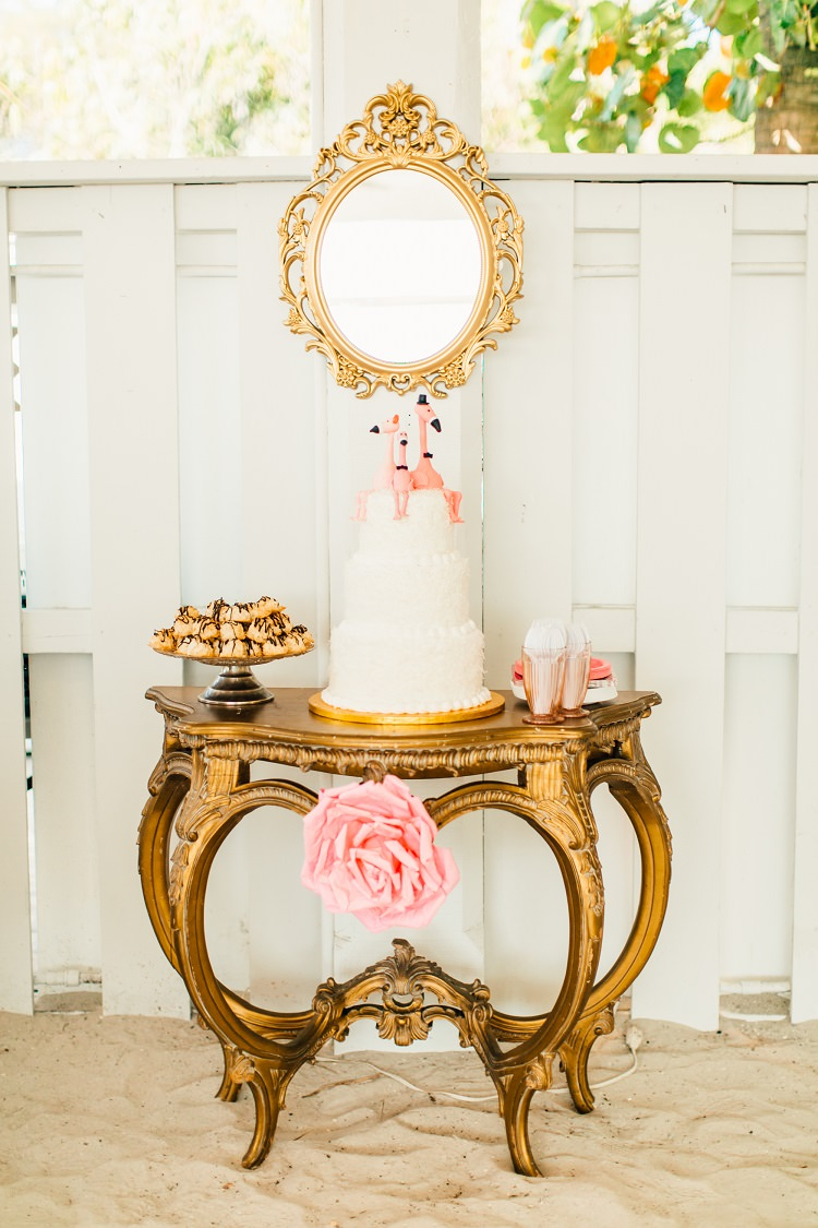 Cake Table Mirror Paper Pom Pom Coconut Tiered Pink Gold Flamingos Pineapples Florida Destination Wedding http://www.findinglightphotography.com/
