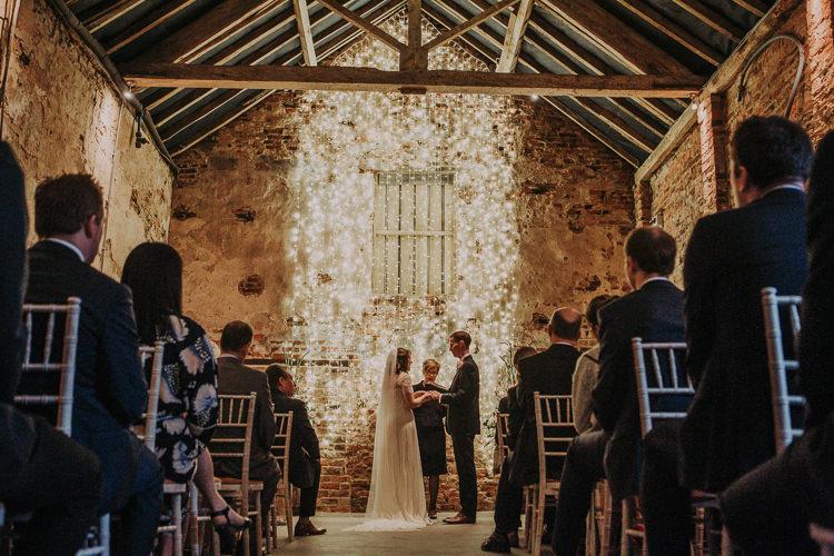 Fairy Lights Ceremony Rustic Charm Contemporary Pastel Barn Wedding http://www.bloomweddings.co.uk/